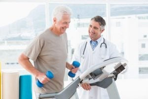 Doctor Therapist consulting with person on tread mill