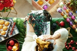 stressed woman untangling lights | Activated You