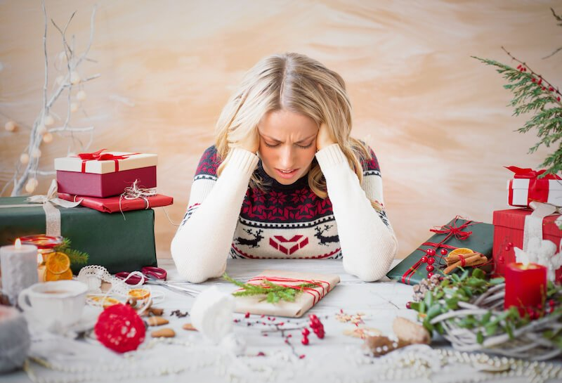 woman feeling holiday stress | Activated You