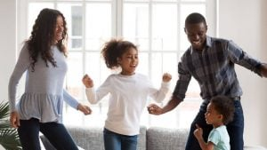 family dancing together