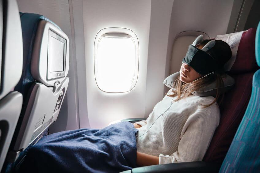 teen sleeping on plane