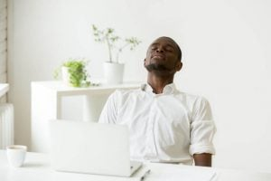 businessman doing relaxation breathing   Activated You