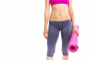 carrying a rolled yoga mat | Activated You